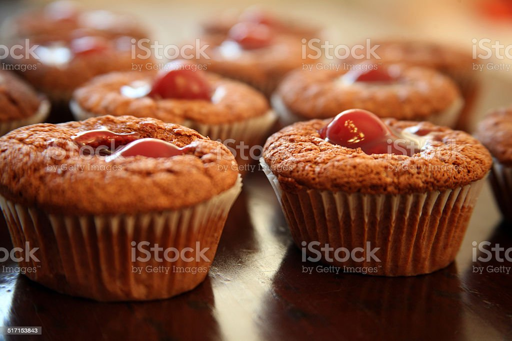 Chocolate muffins with cherry stuffing royalty-free stock photo