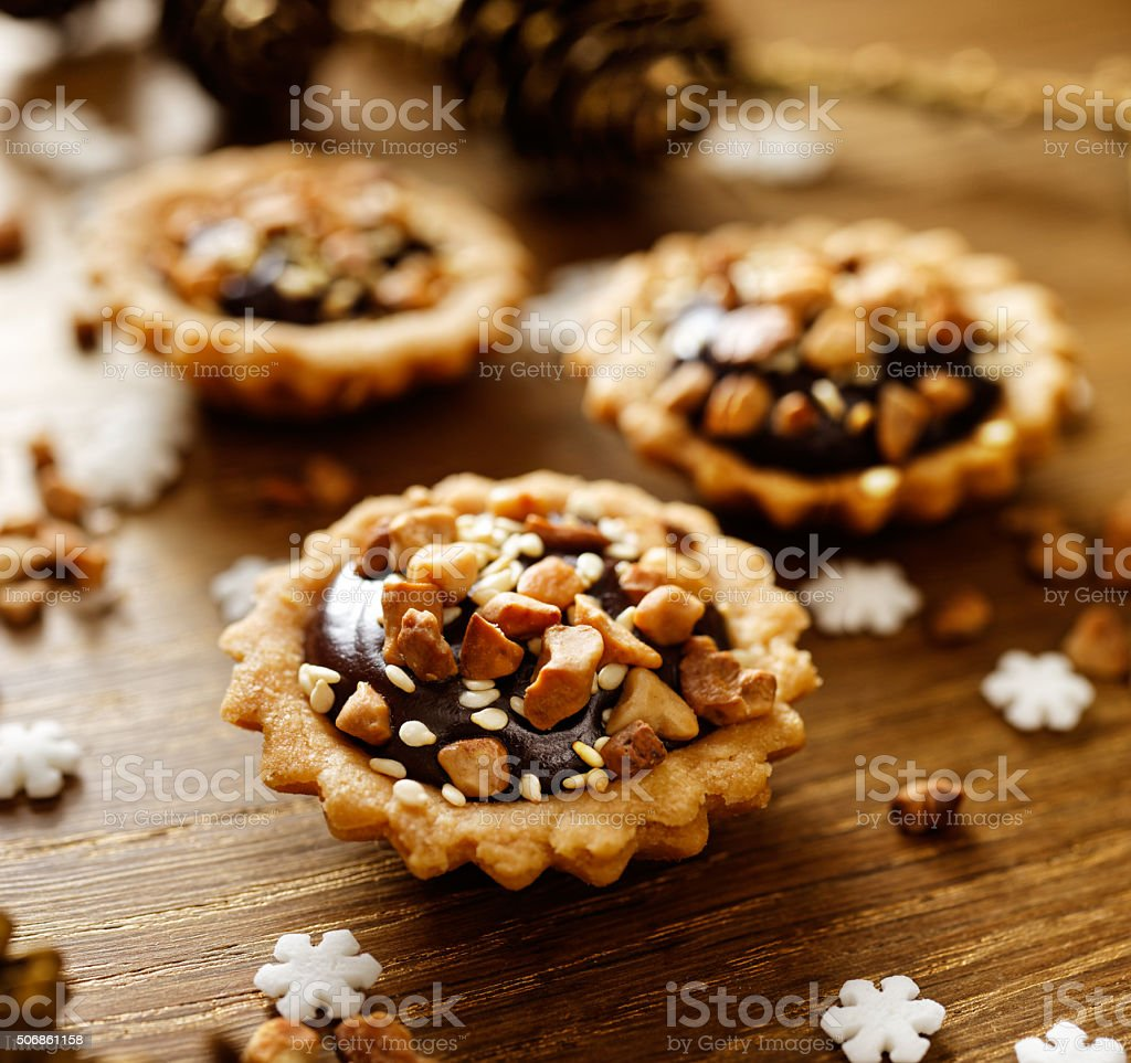 Chocolate nut small tarts. A delicious Christmas dessert stock photo