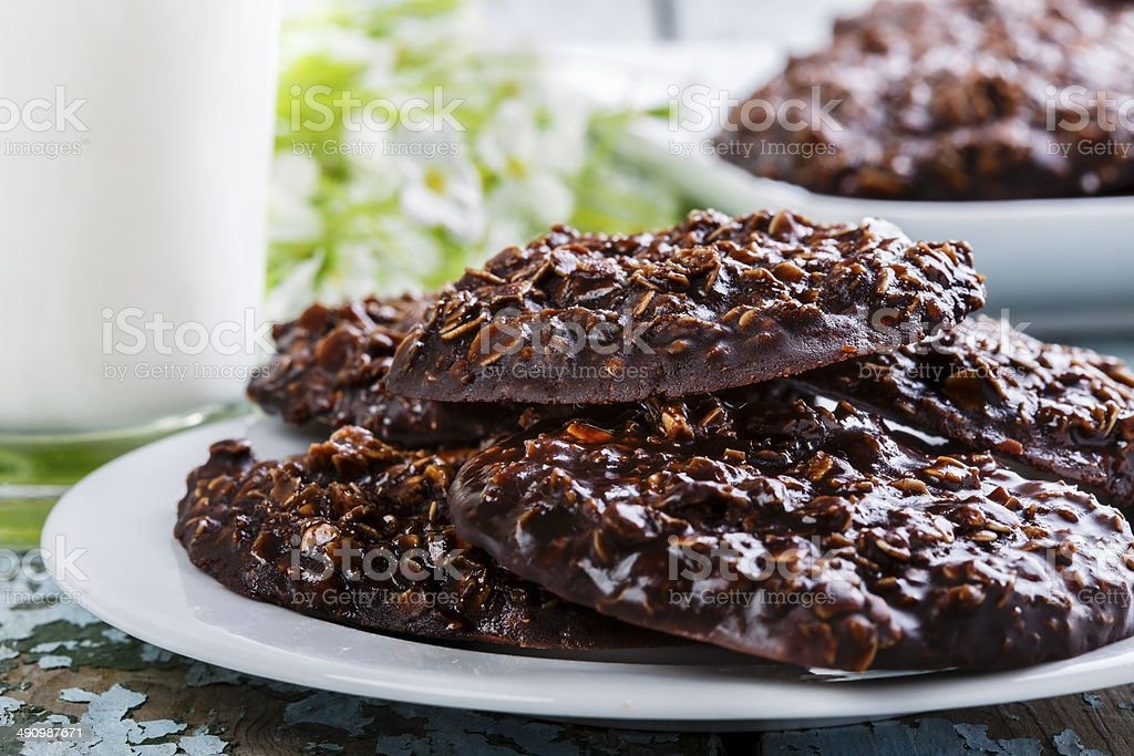 chocolate oatmeal cookies with milk stock photo