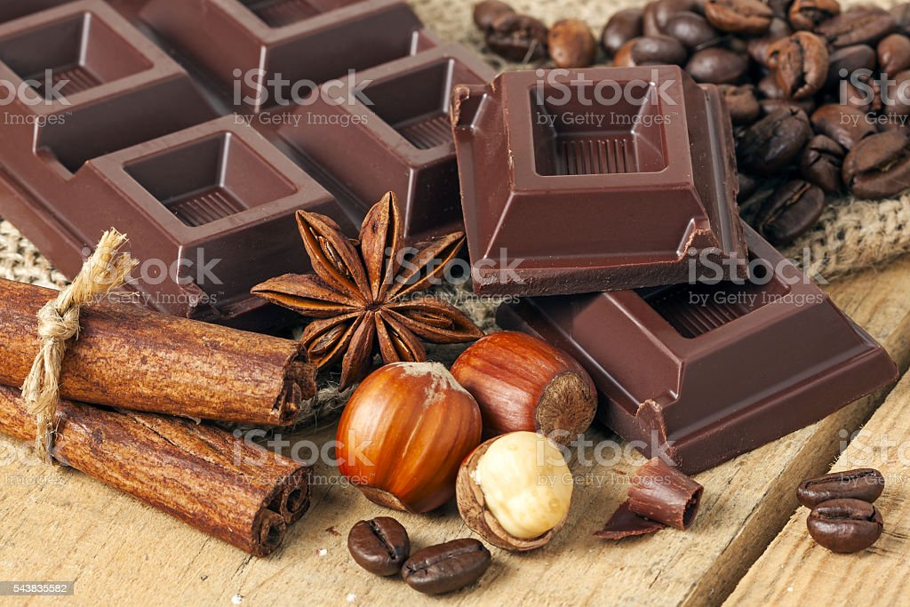 Chocolate on wood background - food stock photo