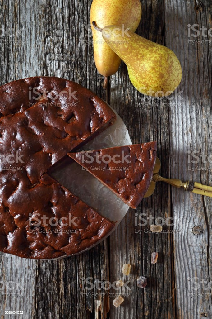 Chocolate pear cake and two pears stock photo