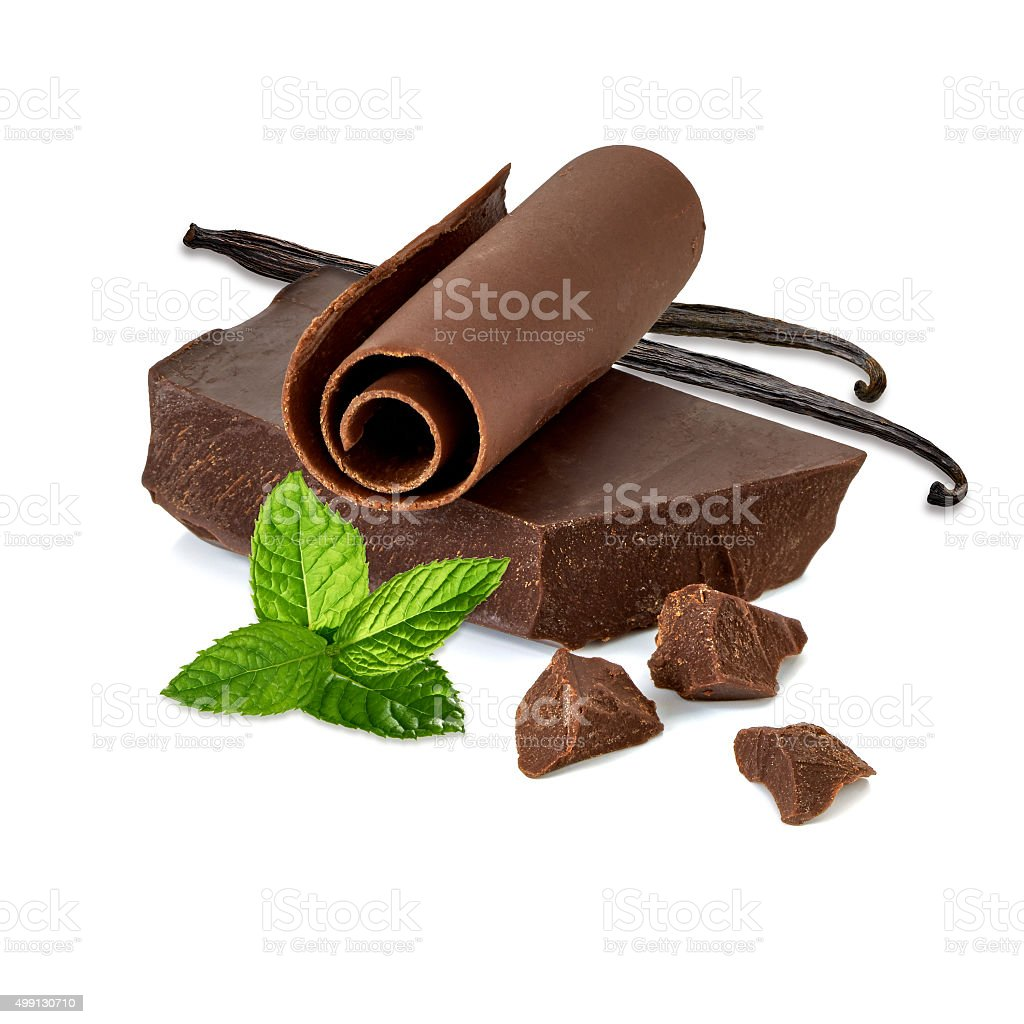Chocolate pieces and curl with vanilla sticks stock photo