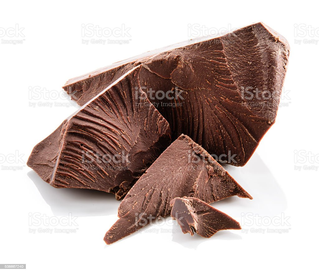 Chocolate. Pieces isolated on white. stock photo