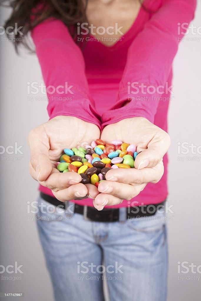 chocolate pills on palm stock photo