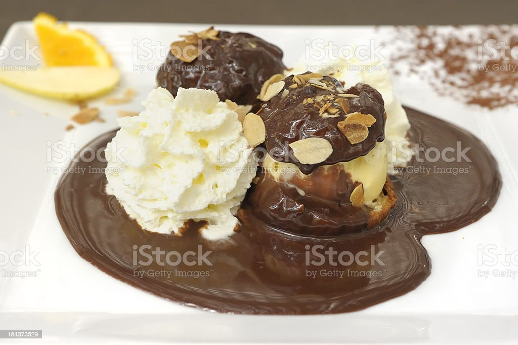 Chocolate profiteroles and cream royalty-free stock photo