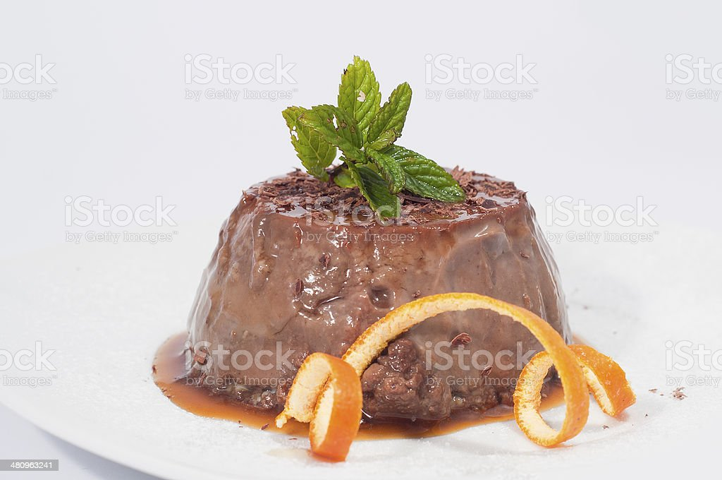 chocolate pudding decorated with mint and orange peel stock photo