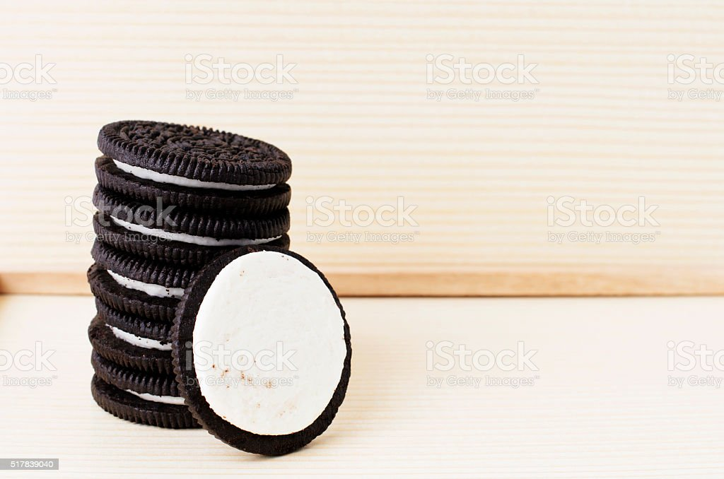Chocolate sandwich cookies on wooden background stock photo