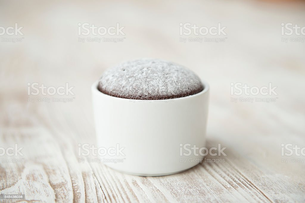 Chocolate Souffle on a wooden table stock photo