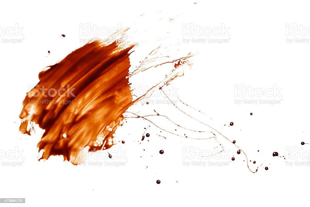 chocolate splash drop liquid white background stock photo