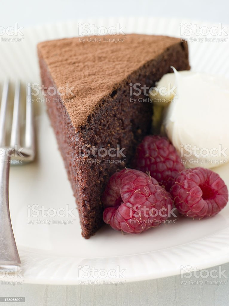 Chocolate Sponge with Whipped Cream and Raspberries royalty-free stock photo