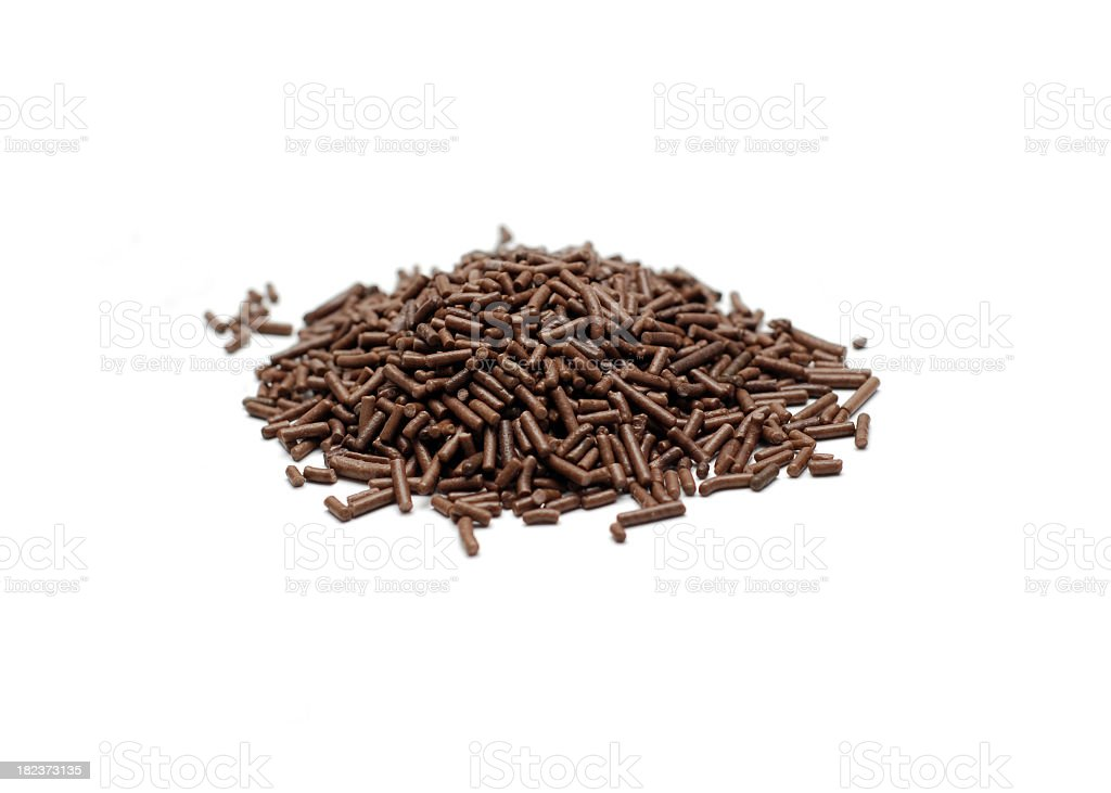 Chocolate sprinkles on white background stock photo