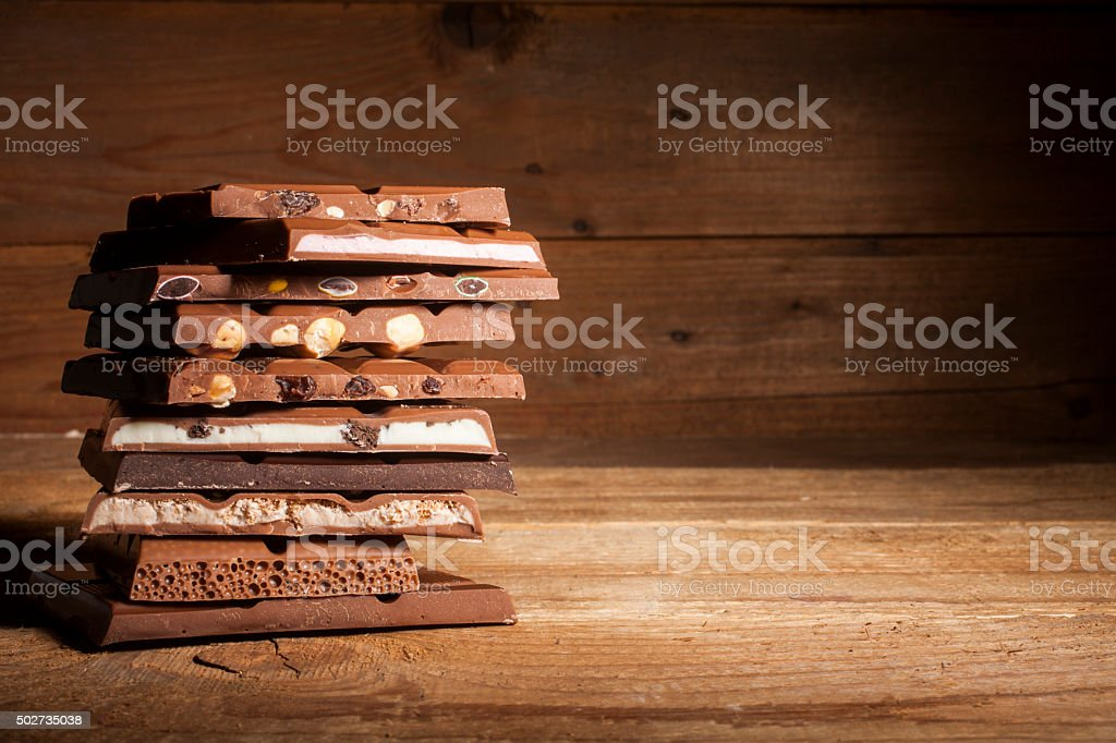 Chocolate stack on wooden background stock photo