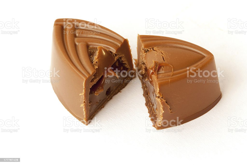 Chocolate sweet cut in two parts royalty-free stock photo