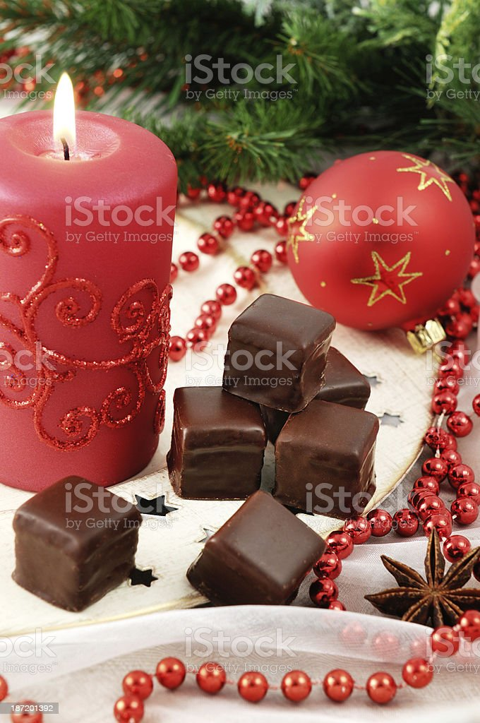 chocolate sweets domino on plate with christmas decoration royalty-free stock photo