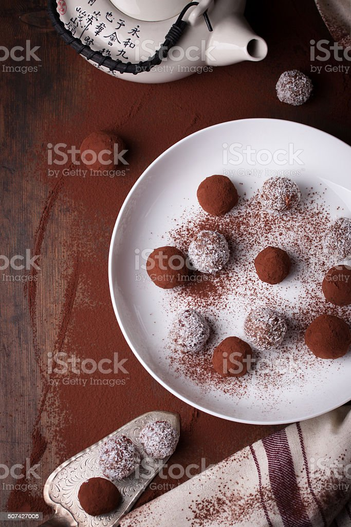 Chocolate sweets with cocoa and coconut chips stock photo
