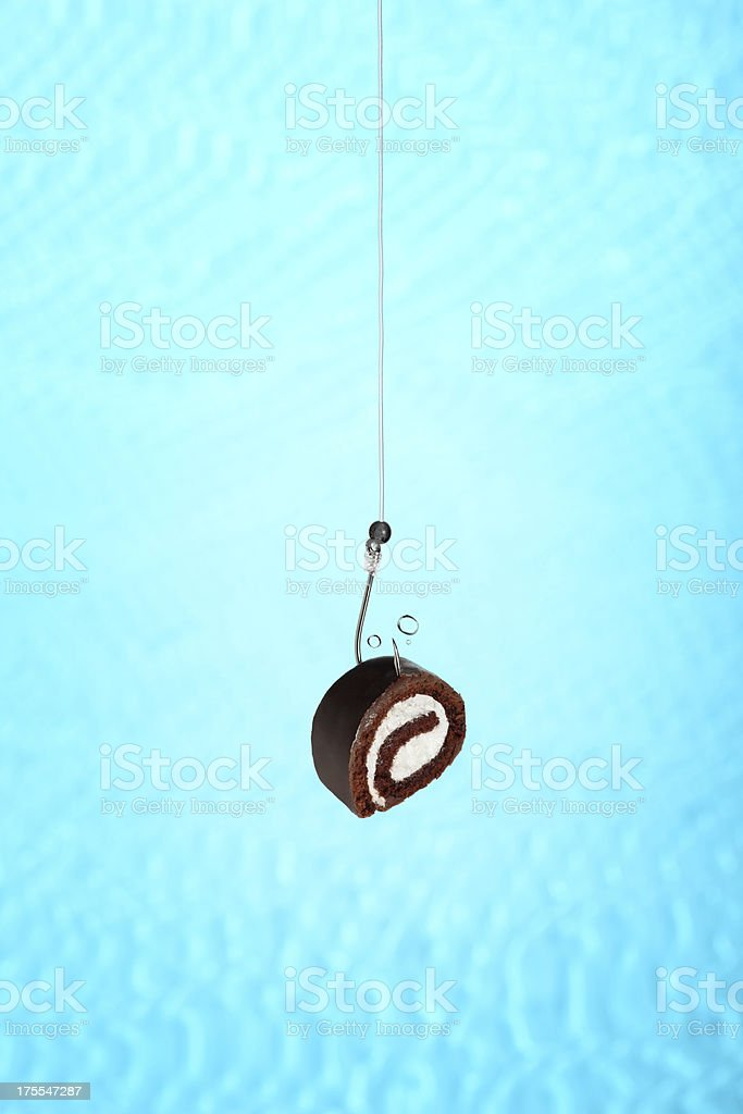Chocolate Swiss Roll on a Fishing Hook stock photo