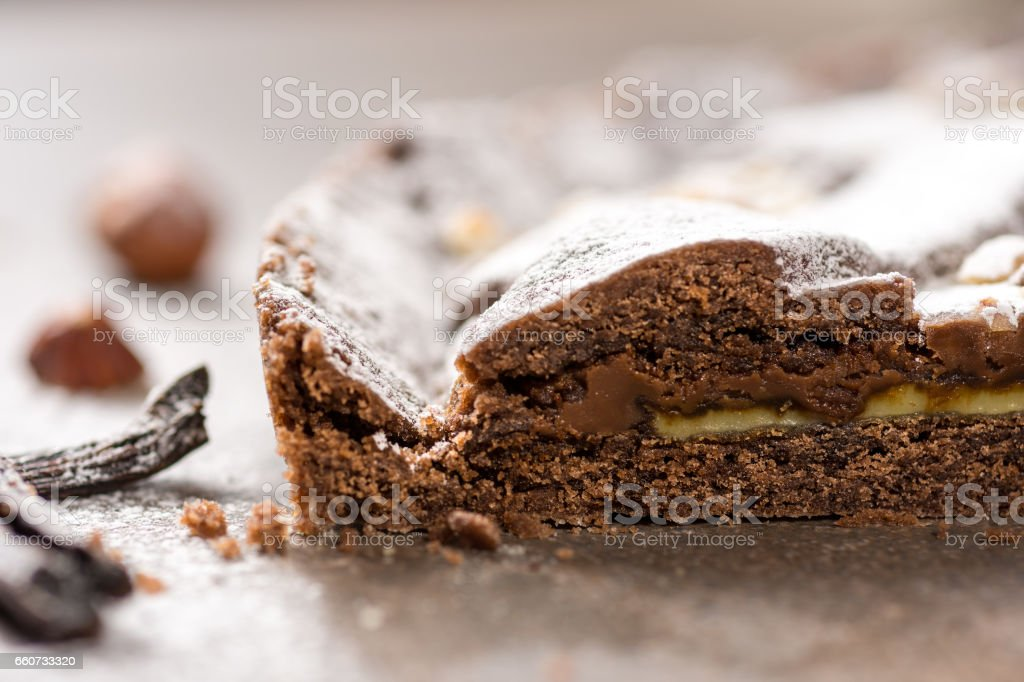 Chocolate Tart Pie Topped with Hazelnuts and Sprinkled with Powdered Sugar stock photo
