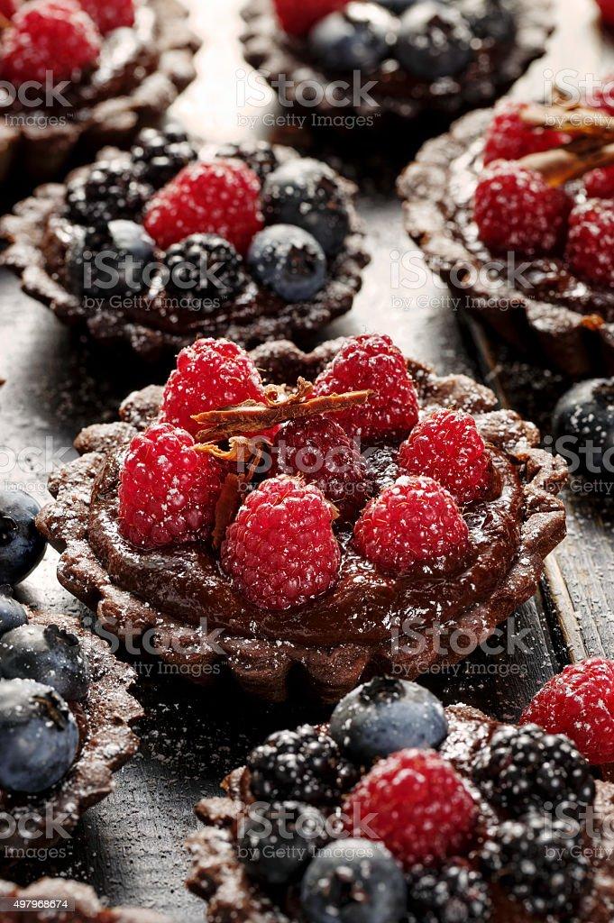 Chocolate tart with fresh raspberries stock photo