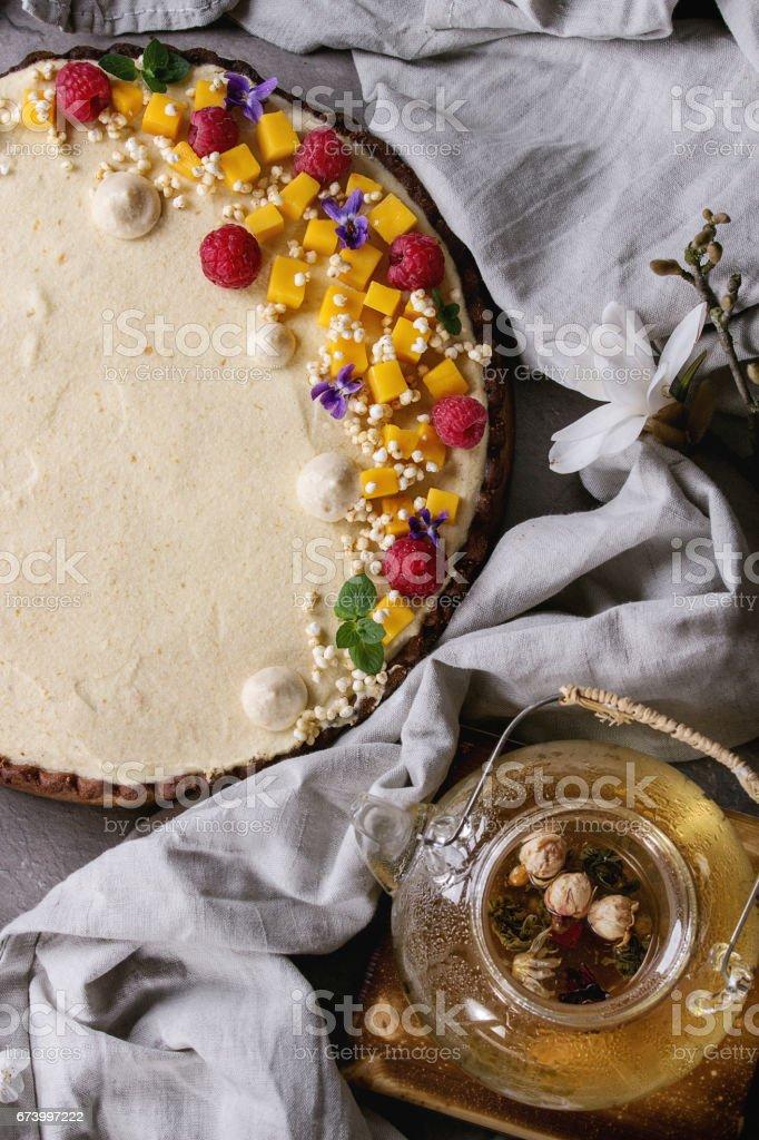 Chocolate tart with mango and raspberries stock photo
