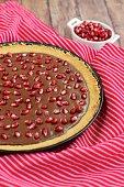 Chocolate tart with pomegranate arils