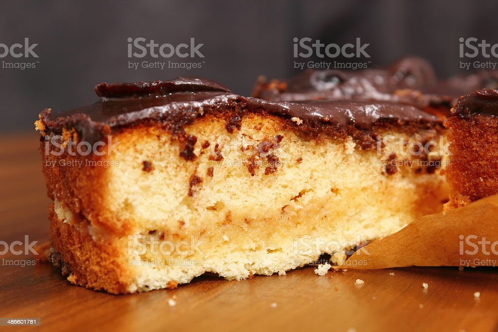 Chocolate Topped Sponge Cake with Prunes and Toffee Sauce stock photo