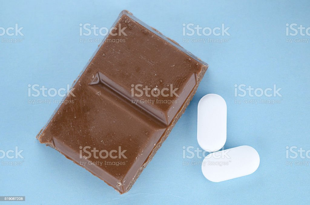Chocolate triggers migraine headaches concept stock photo