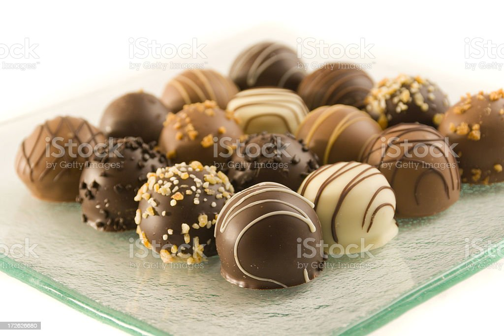 Chocolate Truffle Candy Variety on Plate Still Life on White royalty-free stock photo