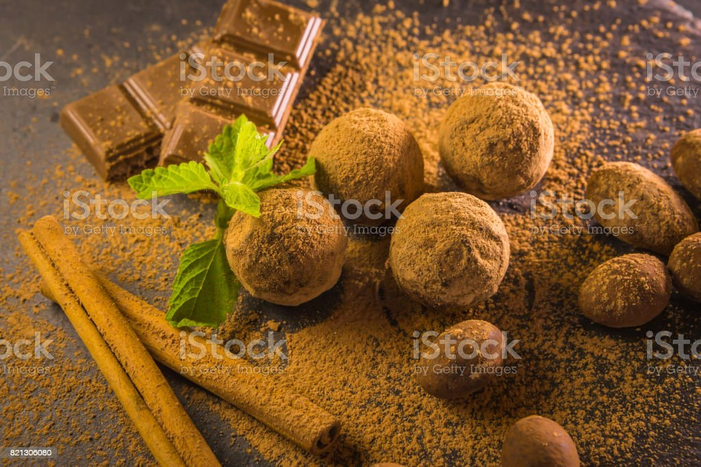 Chocolate truffle. Chocolate sweets on the table with mint and vanilla on the table stock photo
