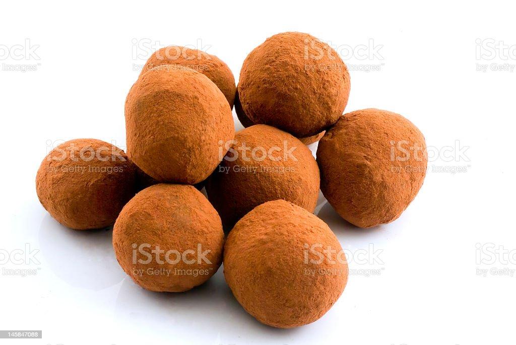 Chocolate truffles on white background royalty-free stock photo