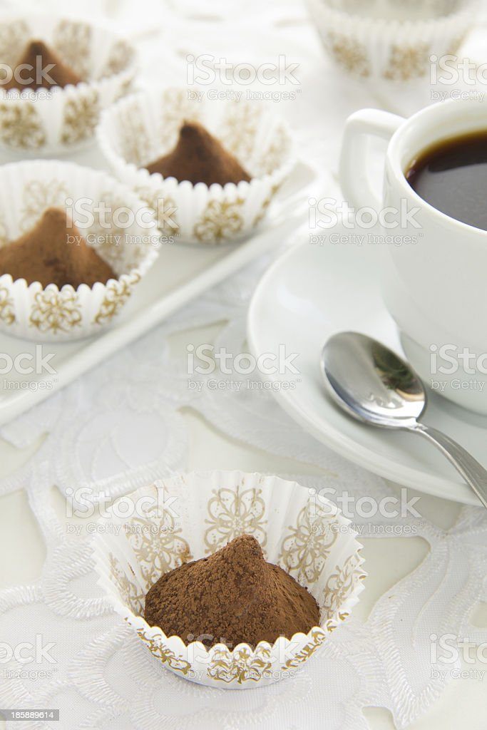 Chocolate truffles with a Cup of coffee. royalty-free stock photo