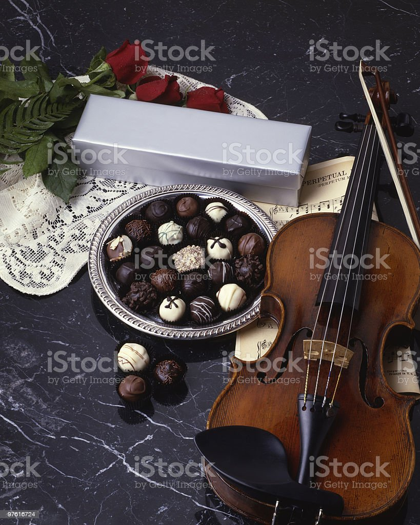Chocolate Truffles with Roses, Violin on Black Marble 4x5 Film royalty-free stock photo