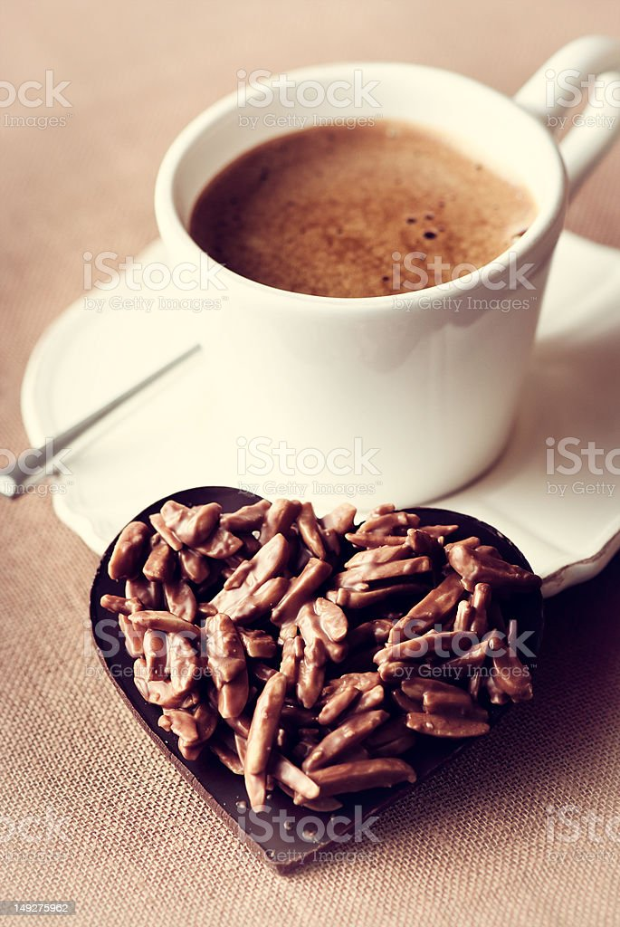 Chocolate valentine's heart and a cup of espresso stock photo
