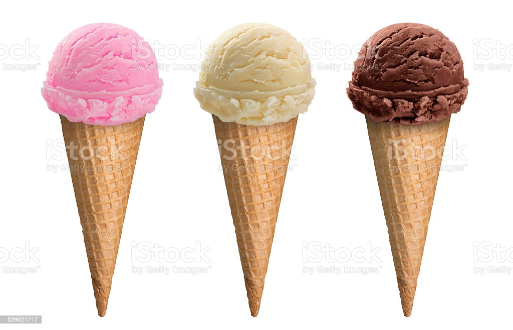 Chocolate, vanilla and strawberry ice cream scoop in waffle cone stock photo