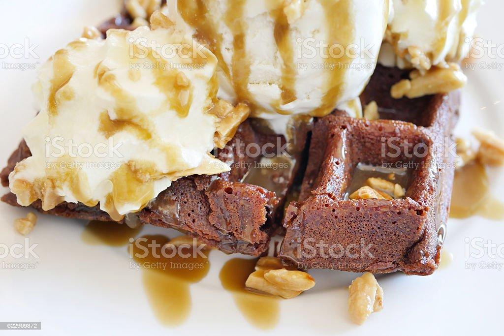 chocolate waffle topped with vanilla ice cream stock photo