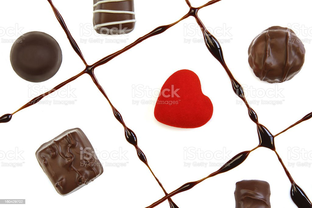 Chocolates and red heart royalty-free stock photo