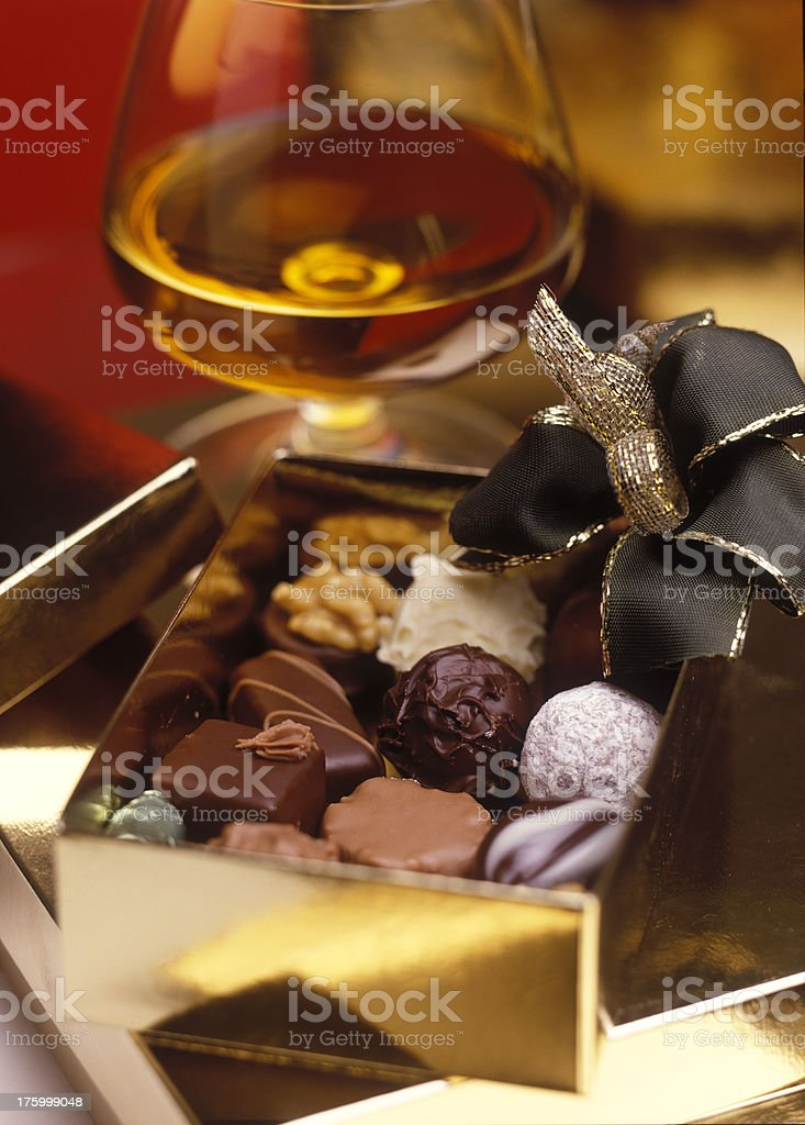 chocolates in present box with cognac stock photo