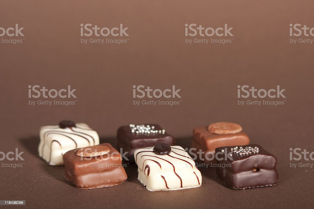 Chocolates on a brown background stock photo