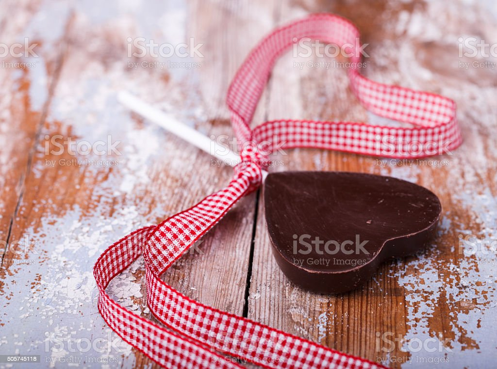 Chocolates on sticks in the shape of a heart stock photo