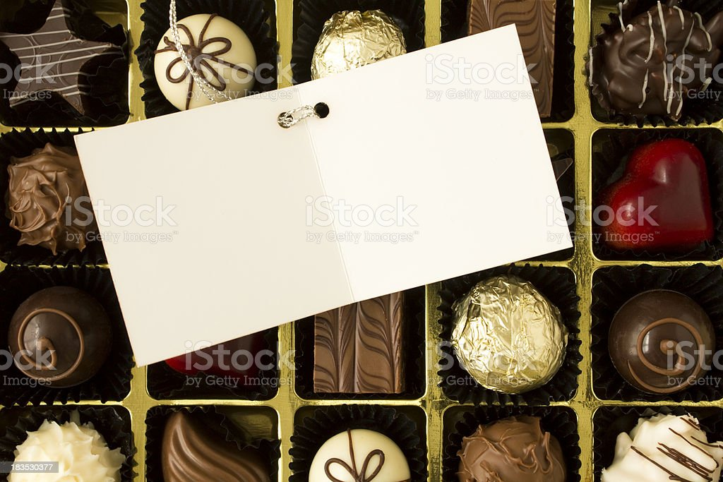 Chocolates with gift card royalty-free stock photo