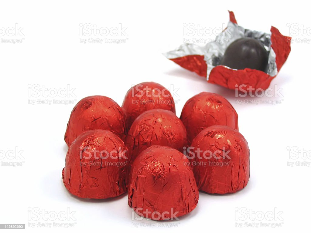 Chocolates wrapped in red stock photo