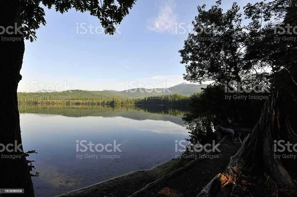 Chocorua Morning Shore with Background Mountain stock photo