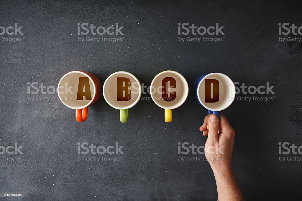 Choice a colorful coffee cup on blackboard stock photo