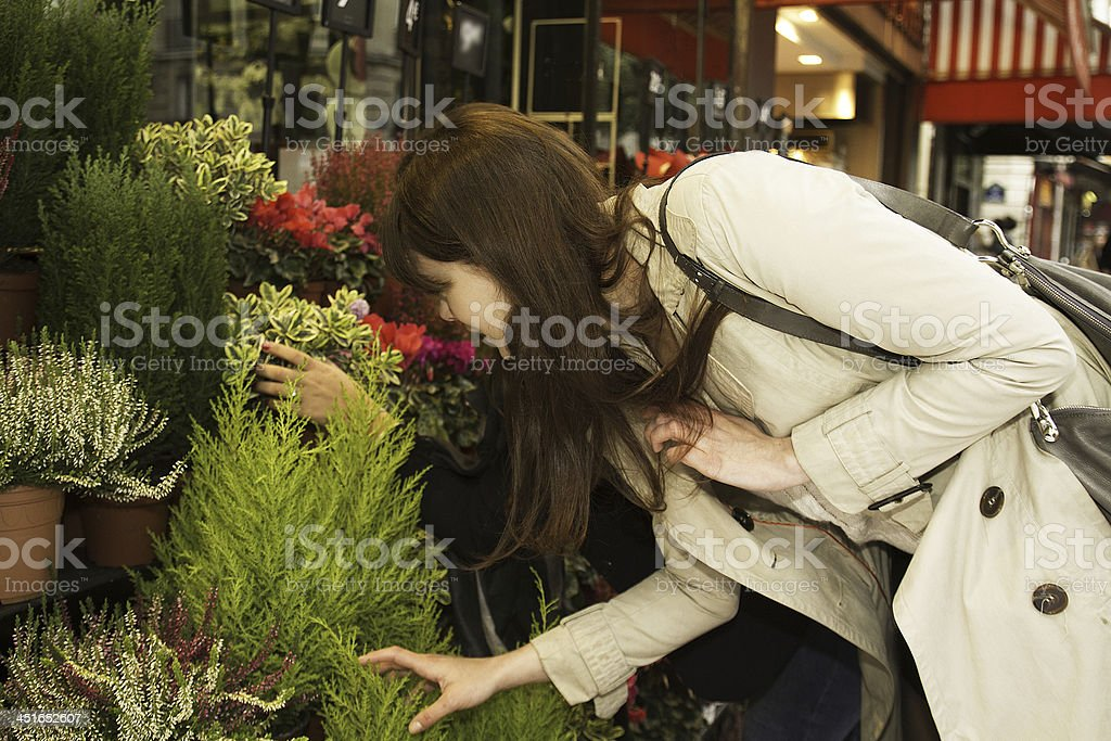 Choice of flowers by two friends who go shopping stock photo