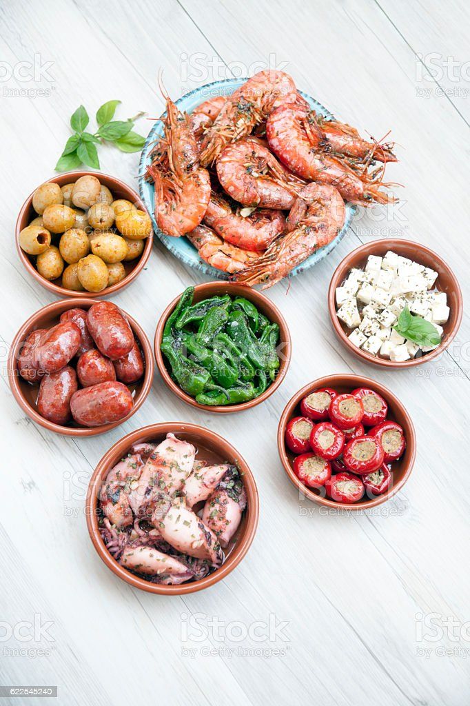 Choice of tasty Spanish tapas on a wooeden table stock photo