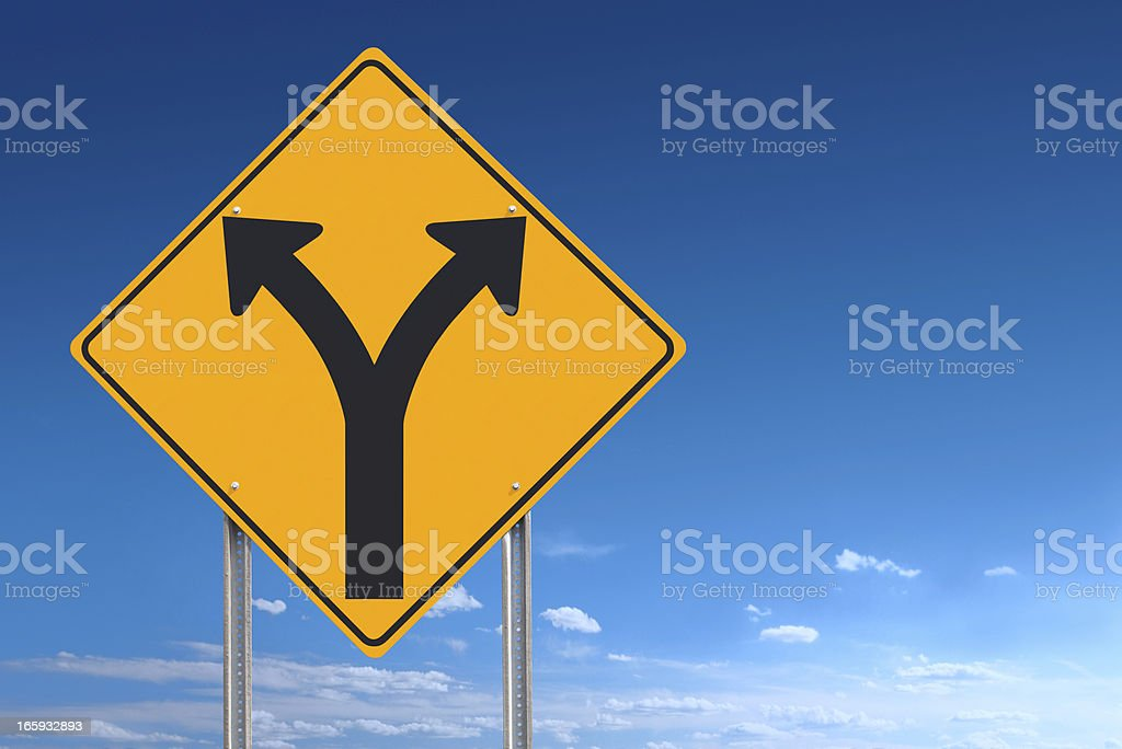 Choice or Division Ahead Road Sign Post on Blue Sky stock photo