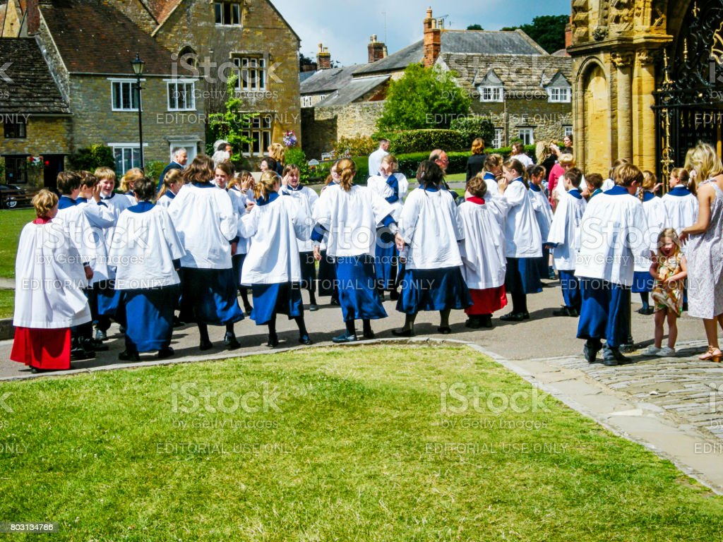 Choir Boys and Girls in their robes at Sherborne Abbey Dorset, UK stock photo