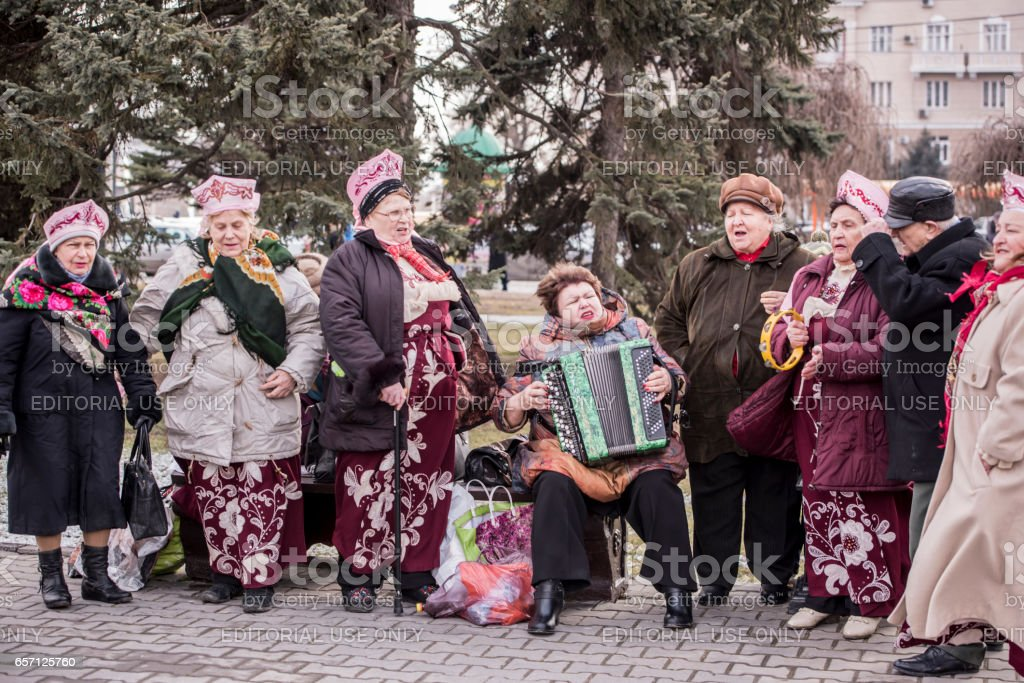Choir of elderly women singing in the park at Carnival stock photo