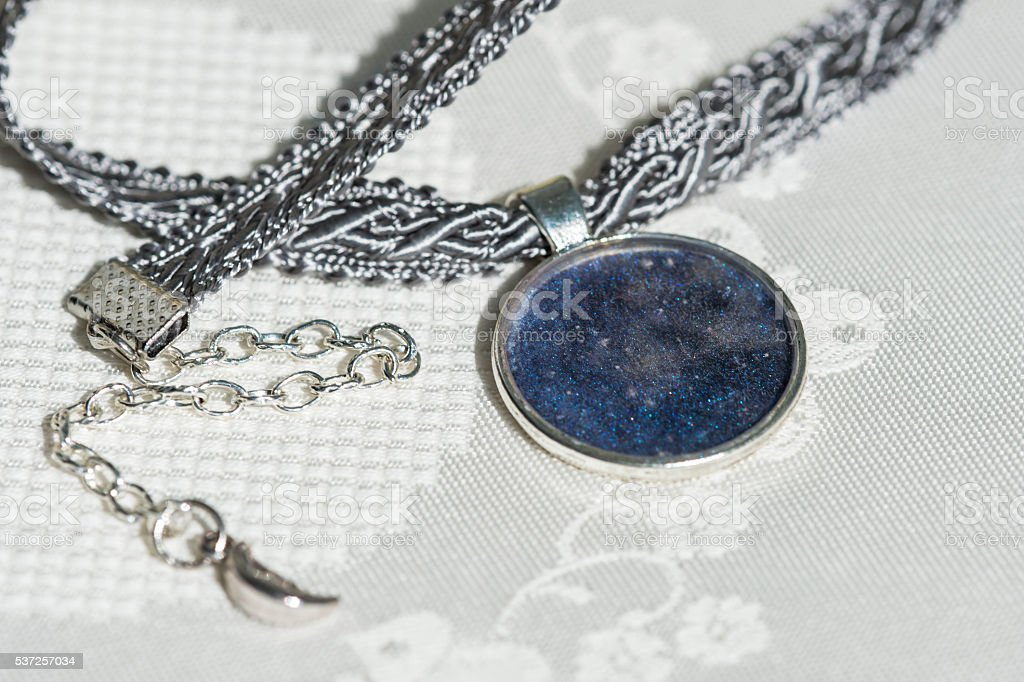 Choker necklace from ribbon and pendant of an epoxy resin stock photo