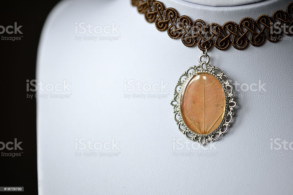 Choker necklace with a pendant from epoxy resin stock photo