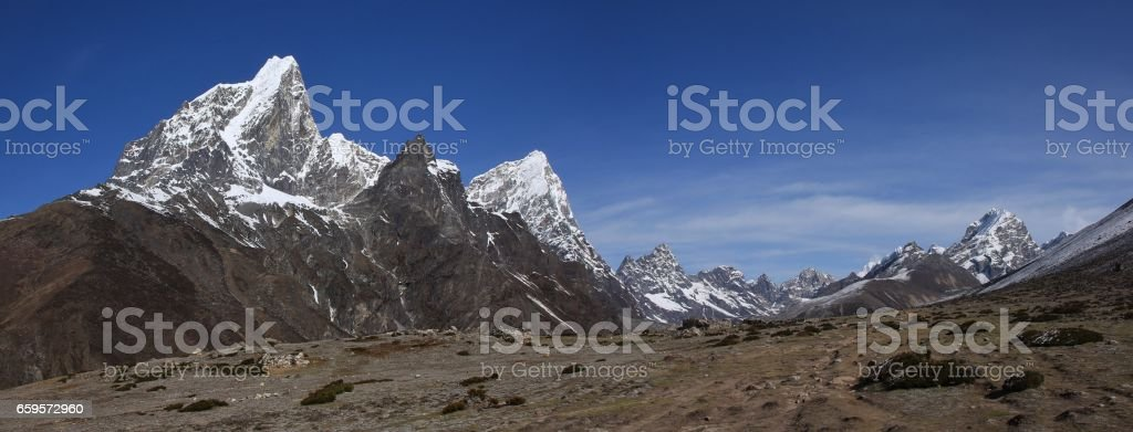 Cholatse and other mountains stock photo